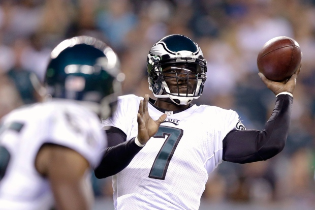 0e22cf81b1a Philadelphia Eagles' Michael Vick. Philadelphia Eagles' Michael Vick passes  during ...