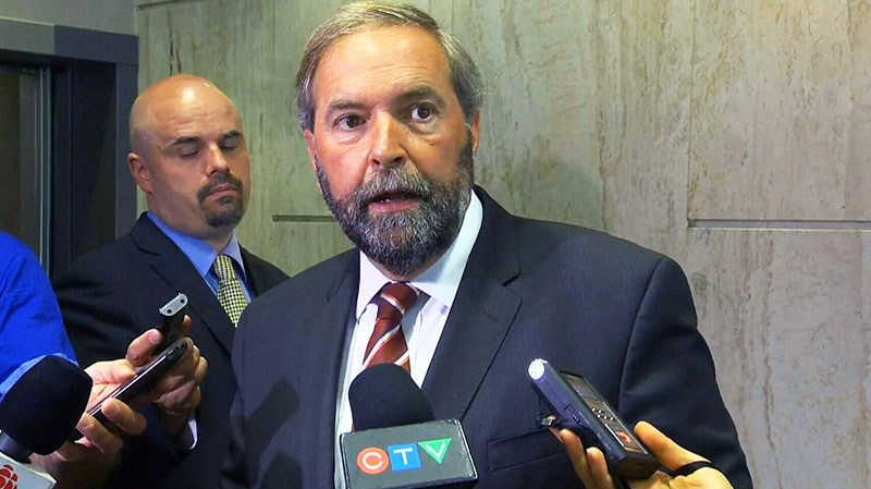 NDP Leader Thomas Mulcair speaks to the media in Montreal on Tuesday, Aug. 20, 2013.