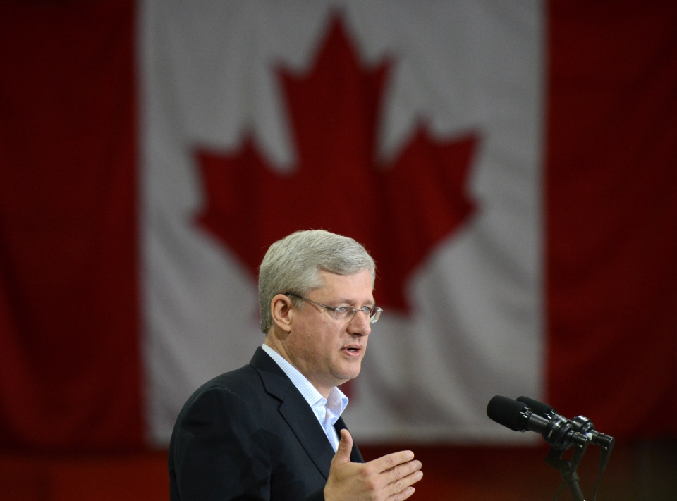 Prime Minister Stephen Harper answers questions following an announcement in Hay River, Northwest Territories on Tuesday, August 20, 2013. (Sean Kilpatrick / THE CANADIAN PRESS)