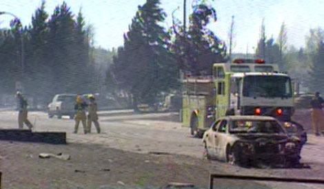 Fire crews tour the fire-ravaged town of Slave Lake, Alta., Thursday, May 19, 2011.