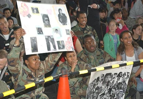 In this photo released by the U.S. Army Japan, Michael Jackson fans await the arrival of the U.S. pop icon at Camp Zama, home to the U.S. Army Japan and other units, located south of Tokyo, on Saturday. (AP / U.S. Army, Tetsuo Nakahara)