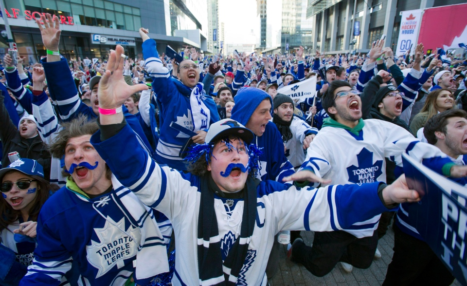 Toronto Maple Leafs fans celebrate a goal while watching a playoff game at Maple Leaf Square in Toronto on Monday, May 13, 2013. (The Canadian Press/Frank Gunn)