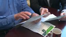 Progressive Conservative Leader Tim Hudak looks at a hydro bill