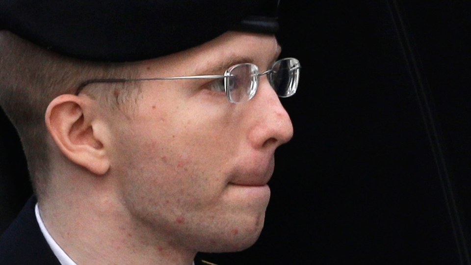 Army Pfc. Bradley Manning is escorted into a courthouse in Fort Meade, Md., Wednesday, Aug. 21, 2013, before a sentencing hearing in his court martial. (AP / Patrick Semansky)