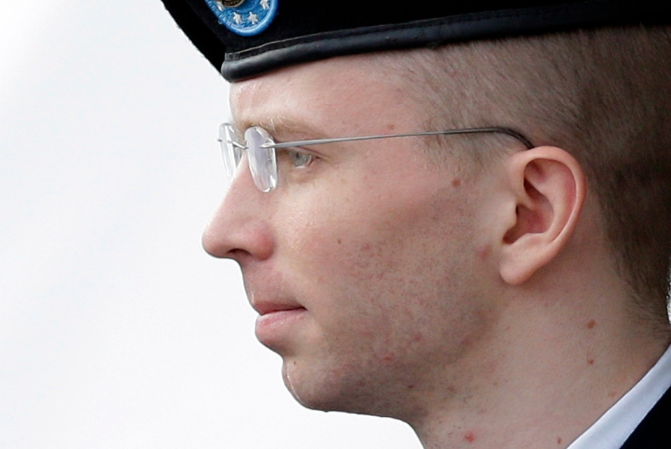 Army Pfc. Bradley Manning is escorted to a security vehicle outside a courthouse in Fort Meade, Md., after a hearing in his court martial. On Wednesday, Aug. 21, 2013. (AP / Patrick Semansky)