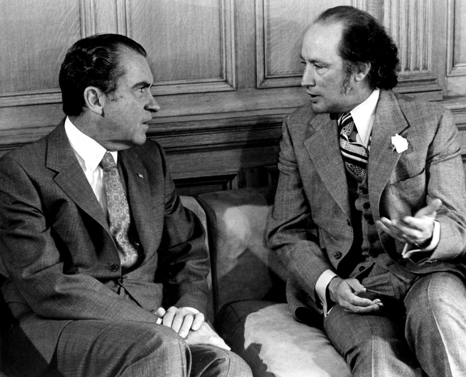 Former U.S. President Richard Nixon and former Prime Minister Pierre Trudeau converse quietly as photographers take pictures in the prime minister's office on April 14, 1972. (Chuck Mitchell / THE CANADIAN PRESS)