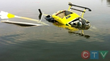 A Bell 212 helicopter is shown after crashing near Canyon Creek on the shore of Lesser Slave Lake, just northwest of Slave Lake on Friday, May 20, 2011. (Courtesy: CTV viewer Lorne Lukan)