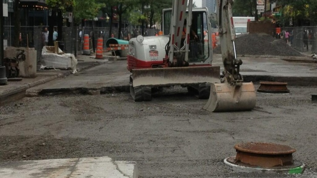 The sinkhole on Ste. Catherine St.  has been fille