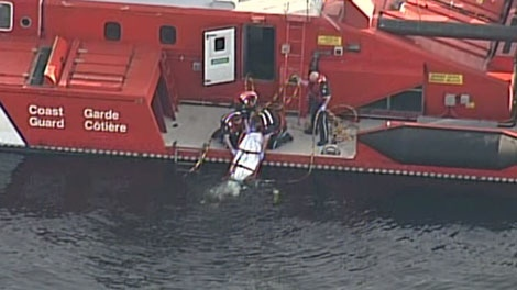 Divers recover a body from a submerged truck at the Swartz Bay ferry terminal in Victoria, B.C. May 20, 2011. (CTV)