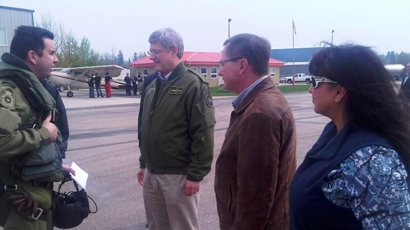 Prime Minister Stephen Harper and Alberta Premier Ed Stelmach visit Slave Lake, Alta. on Friday, May 20, 2011.