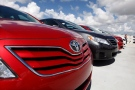 In this file photo, a 2011 Toyota Camry LE sits in a lot at a dealership in Miami. (AP / Lynne Sladky)
