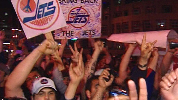 Winnipeg Jet fans celebrate at Portage and Main in downtown Winnipeg following news the Atlanta Thrashers are moving to Winnipeg, late Thursday, May 19, 2011.