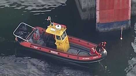 Searchers look for a truck that plunged into the water off Swartz Bay ferry terminal. May 20, 2011. (CTV)