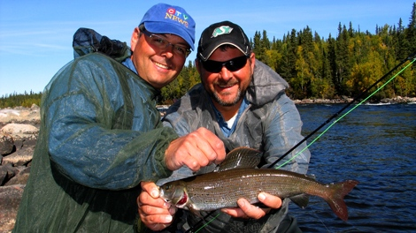 Jeff and Jason holding a gorgeous Arctic Grayling