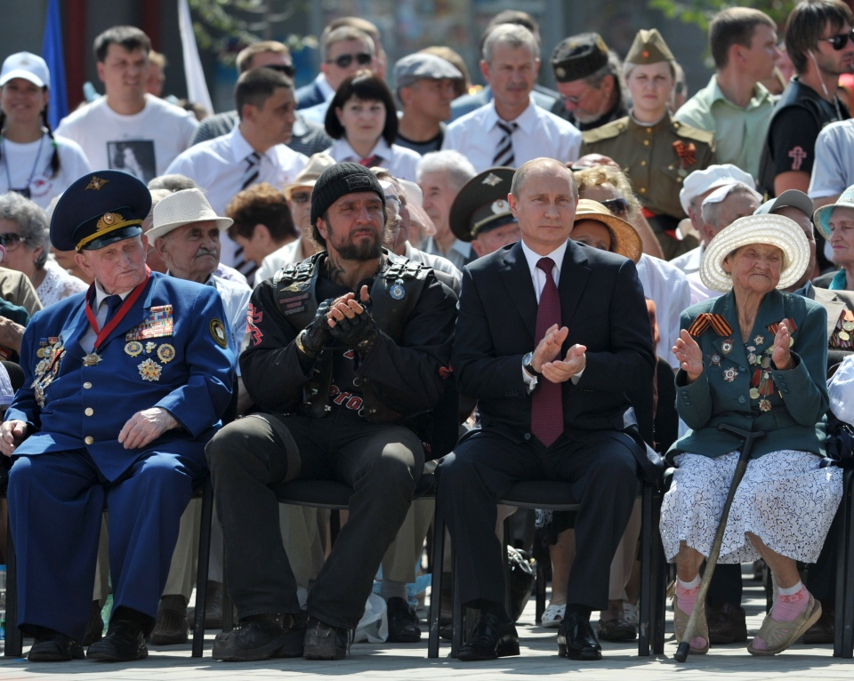 Russian President Vladimir Putin, second right, with World War II veterans and prominent motor biker Alexander Zaldostanov, second left, attends an opening ceremony of newly built fountain called Children Dancing in the southern Russian city of Volgograd, once known as Stalingrad, Friday, Aug. 23, 2013. (RIA-Novosti, Alexei Nikolsky, Presidential Press Service)