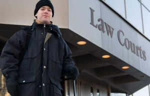 Professor Gabor Lukacs stands outside of the Manitoba law courts in Winnipeg, Thursday, Jan. 20, 2011. (David Lipnowski / THE CANADIAN PRESS)