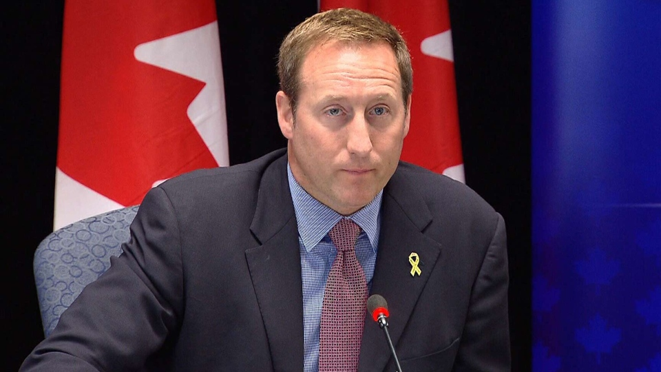 Justice Minister Peter MacKay speaks to reporters in Halifax, Friday, Aug. 23, 2013.
