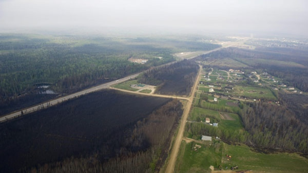 Fire damage is seen from the air as Prime Minister Stephen Harper takes a helicopter tour of the devastation in Slave Lake, Alberta with Premier Ed Stelmach on Friday May 20, 2011. A wildfire swept through the town of 7,000 destroying upwards of 40% of the buildings. THE CANADIAN PRESS/Ian Jackson