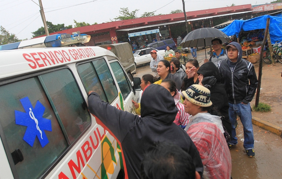 Inmates relatives surround an ambulance leaving the Palmasola jail in Santa Cruz, Bolivia, Friday, Aug. 23, 2013. (AP)