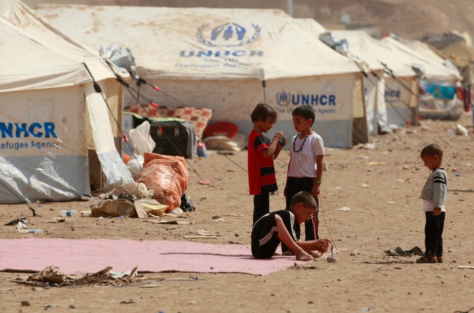 Children play at Kawergost refugee camp in Irbil, 350 kilometres north of Baghdad, Iraq, Wednesday, Aug. 21, 2013. (AP / Hadi Mizban)