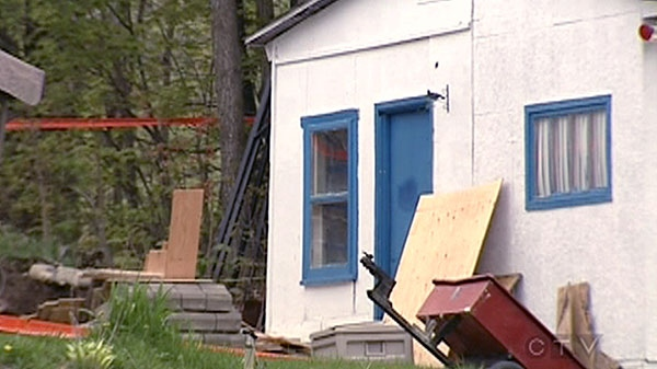 Quebec police have launched an investigation after a body was found in the freezer of a home where a family member was arrested in connection with a murder two years ago.