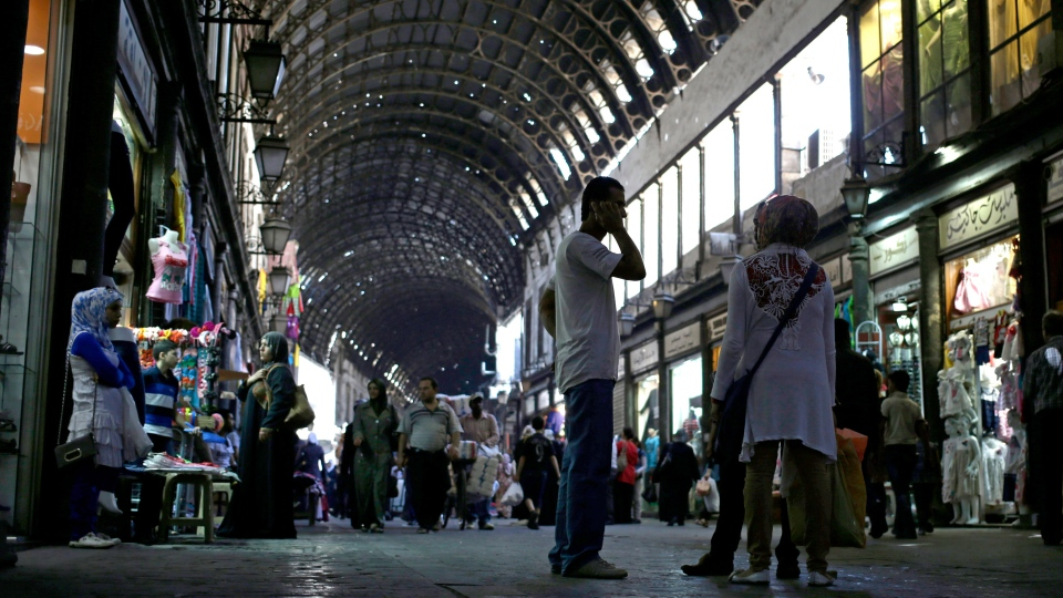 Syrians shop at the popular Hamidiyeh old market, in Damascus, Syria, Thursday, Aug. 22, 2013. (AP / Hassan Ammar)
