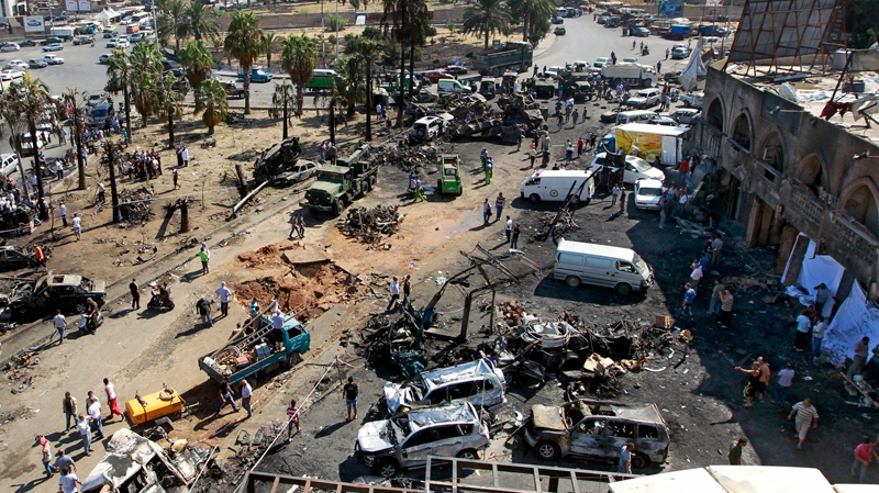 Lebanese Army investigators inspect at the site of a car bomb explosion outside of the Al-Taqwa mosque in the northern city of Tripoli, Lebanon, Saturday, Aug. 24, 2013. (AP / Bilal Hussein)