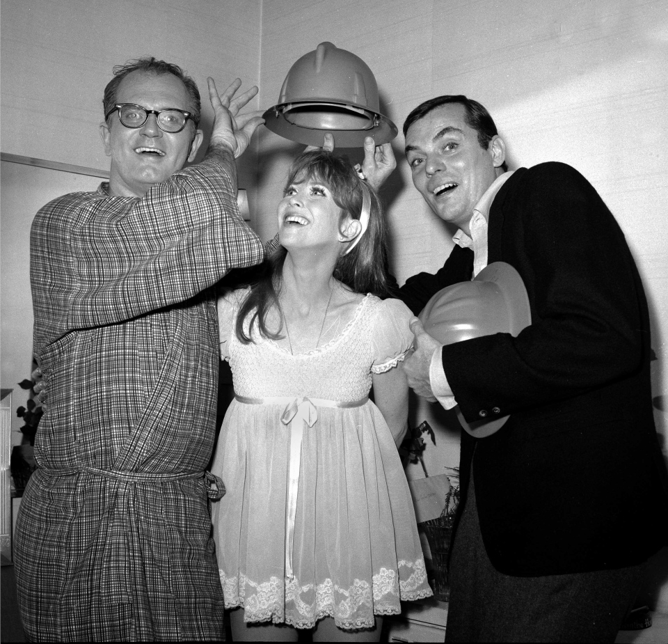 Julie Harris, centre, Charles Nelson Reilly, left, and Peter L. Marshall, stars of 'Skyscraper,' joke backstage at New York's Lunt-Fontanne Theater after the musical comedy premiered on Broadway opening night on Nov. 13, 1965. (AP)