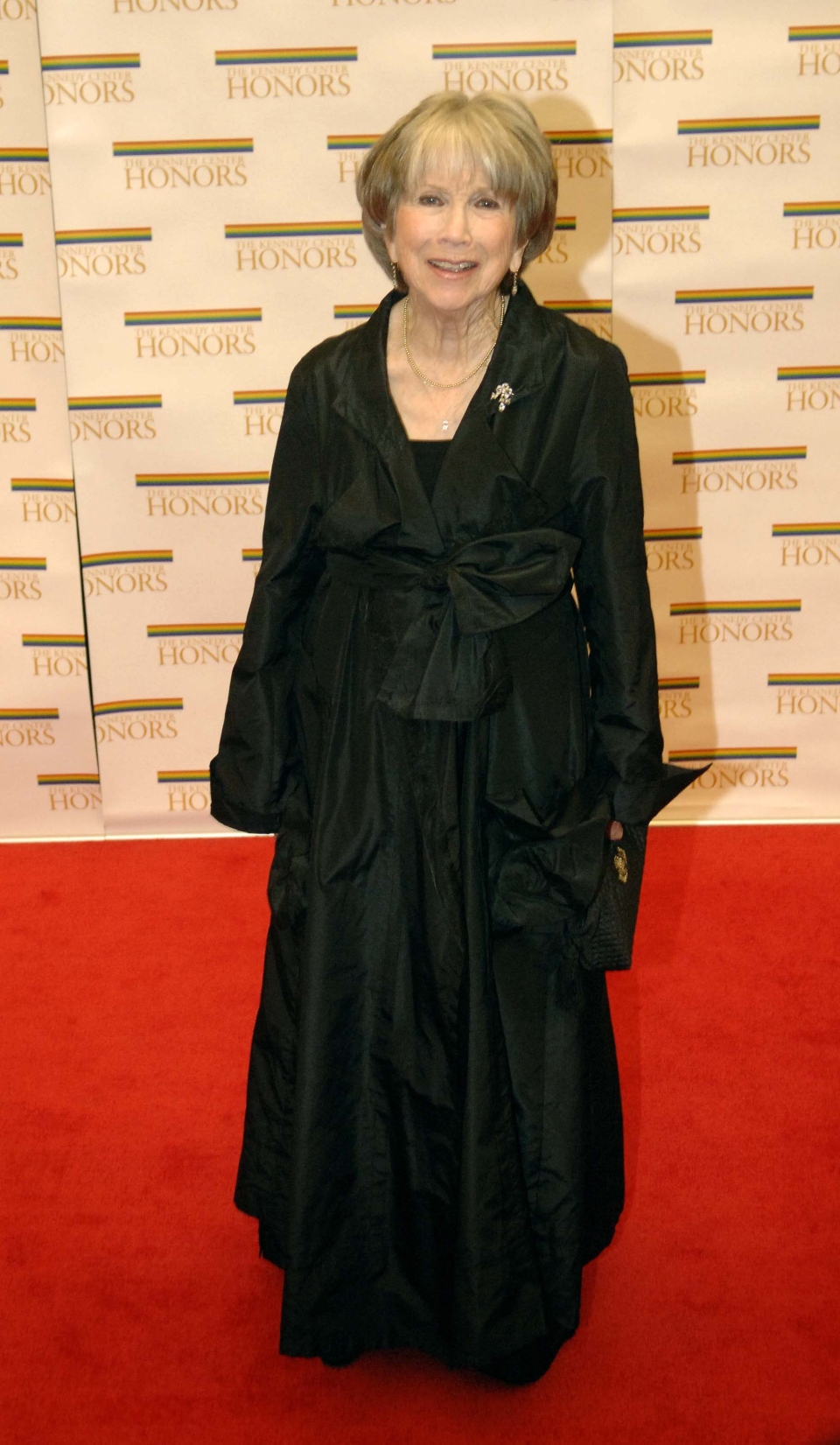 Kennedy Center 2005 honoree actress Julie Harris stops on the red carpet for photos after arriving at the State Department for a dinner hosted by Secretary of State Condoleezza Rice in Washington, Saturday, Dec. 3, 2005. (AP / Kevin Wolf)