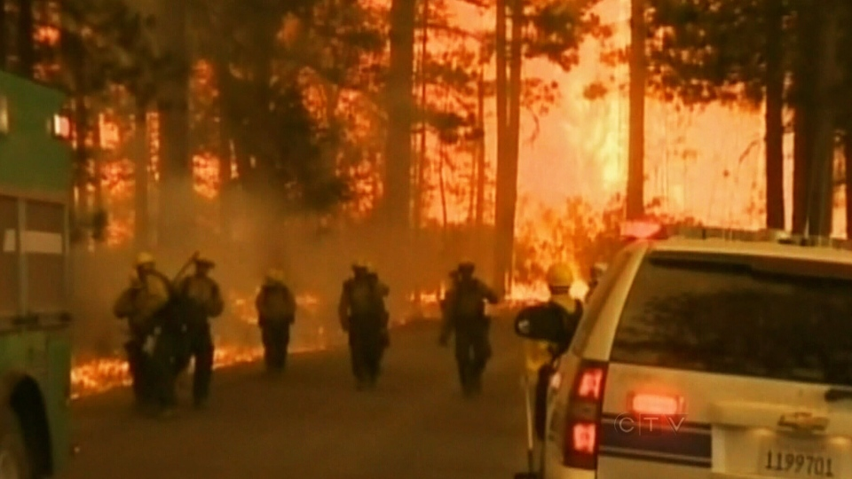 Officials continue to battle a wildfire threatening parts of Northern California including Yosemite National Park on Aug. 24, 2013.