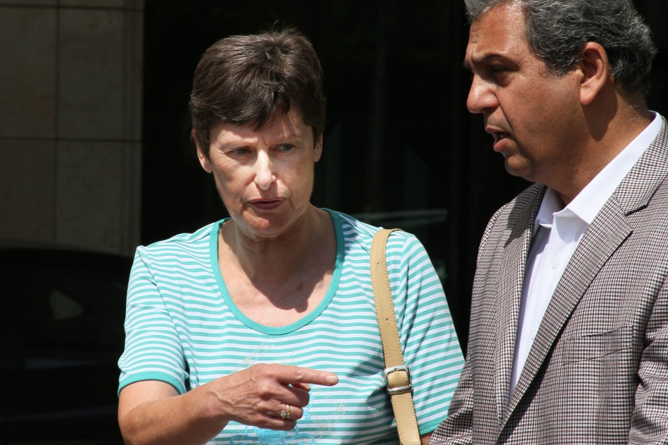 The UN High Representative for Disarmament Affairs, Angela Kane, left, looks towards the UN team convoy, not pictured, as they leave their hotel on the day of a scheduled visit to investigate an alleged chemical attack that killed hundreds last week in Damascus, Syria, Monday, Aug. 26, 2013. (AP)