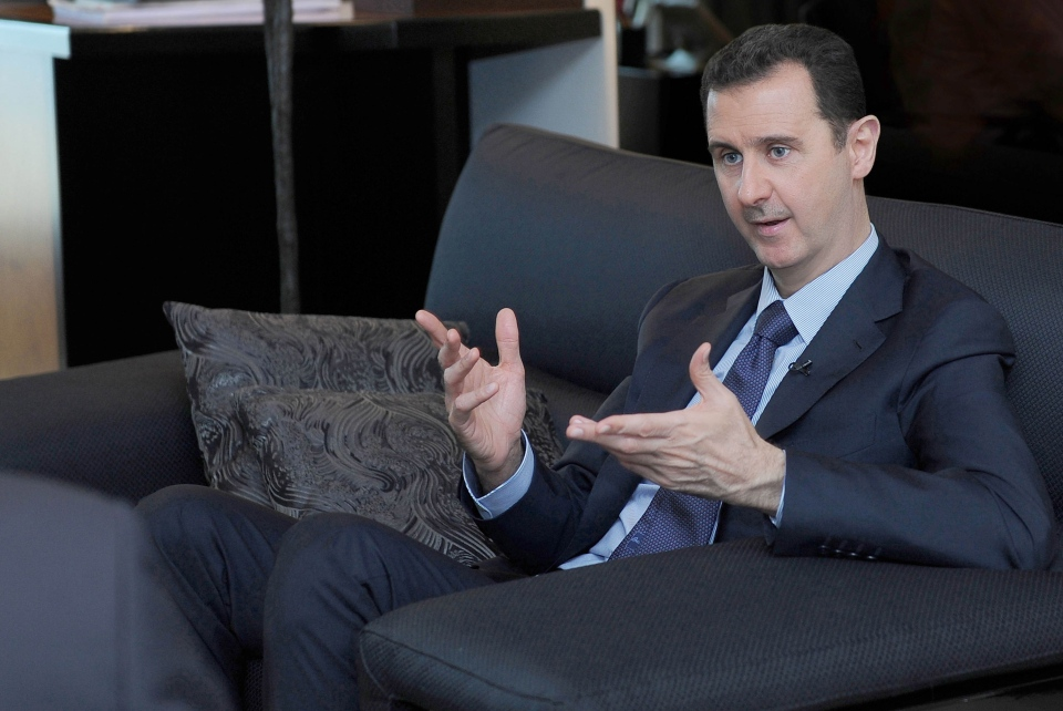 In this undated photo released Monday, Aug. 26, 2013, Syrian President Bashar Assad gestures as he speaks during an interview with a Russian newspaper, in Damascus, Syria. (SANA)