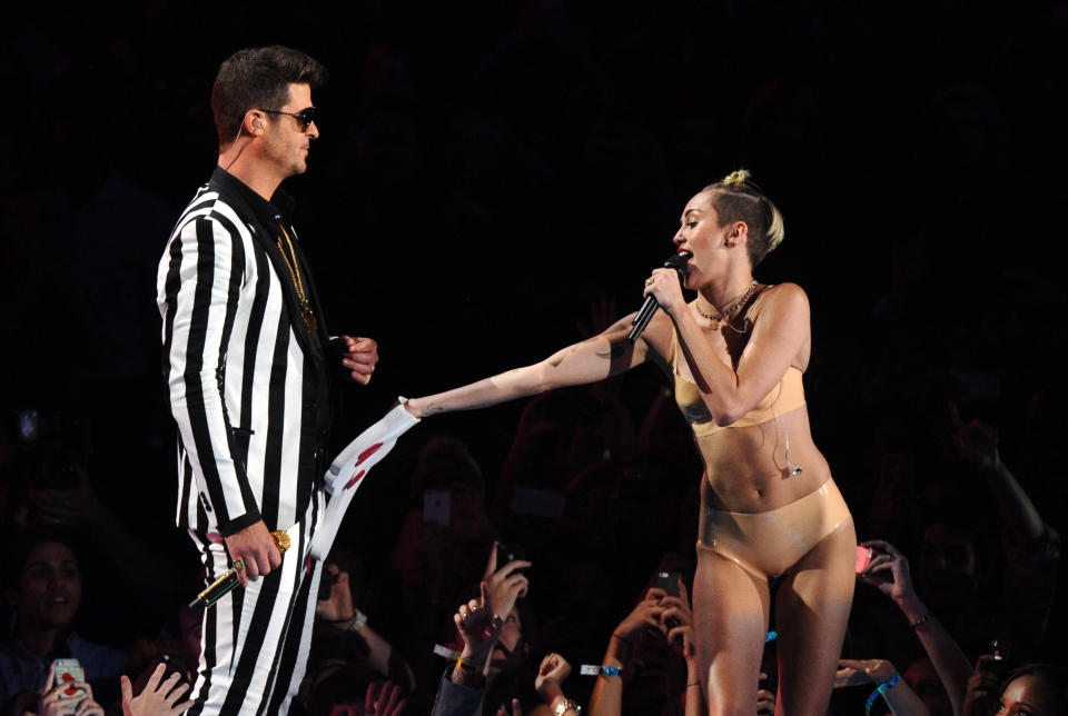 Robin Thicke and Miley Cyrus perform 'Blurred Lines' at the MTV Video Music Awards at the Barclays Center in the Brooklyn borough of New York on Sunday, Aug. 25, 2013. (Charles Sykes / Invision)