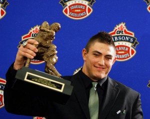John Chick holds his trophy for the CFL Most Outstanding Defensive Player during the 2009 Gibson's Finest Players Awards in Calgary on Nov. 26, 2009. John Chick is returning to the Canadian Football League. The free agent defensive end agreed to terms with the Saskatchewan Roughriders on Saturday, The Canadian Press has learned. THE CANADIAN PRESS/Jeff McIntosh