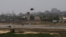 A Pakistani helicopter takes party in an operation against miltants at Pakistan Navy base in Karachi, Pakistan on Monday, May 23, 2011. (AP Photo/Shakil Adil)