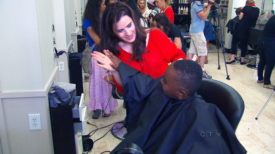A salon owner is giving back by sending kids off to school in style with free haircuts.