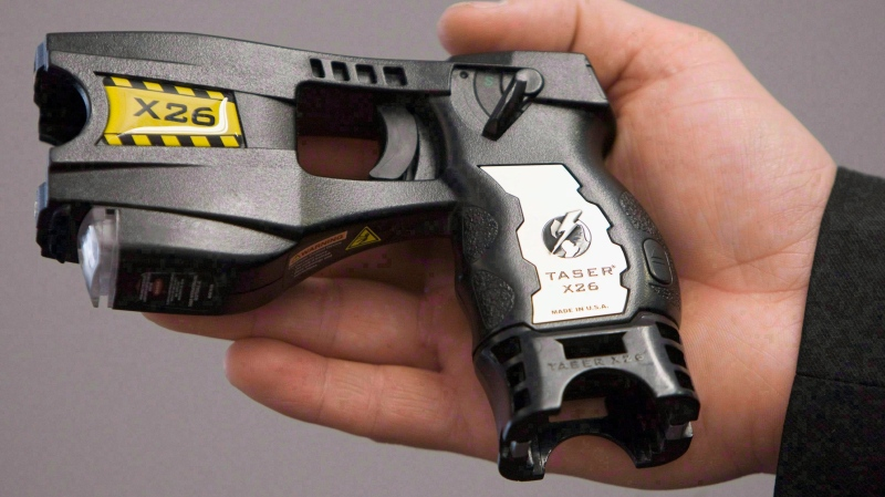 A police-issued Taser is displayed at the Victoria, B.C., police station. (The Canadian Press/Jonathan Hayward)