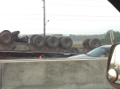 A tractor-trailer overturned in Highway 401's eastbound lanes in Whitby on Tuesday, Aug. 27, 2013. (@Kubbinga/Twitter)