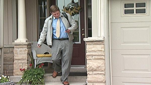 Financial advisor Kyle Stewart prepares to head to work in Kitchener, Ont.