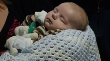 Doctors say 10-week-old Kaleb Busch suffered a massive heart attack at birth that caused the left side of his heart to fail.