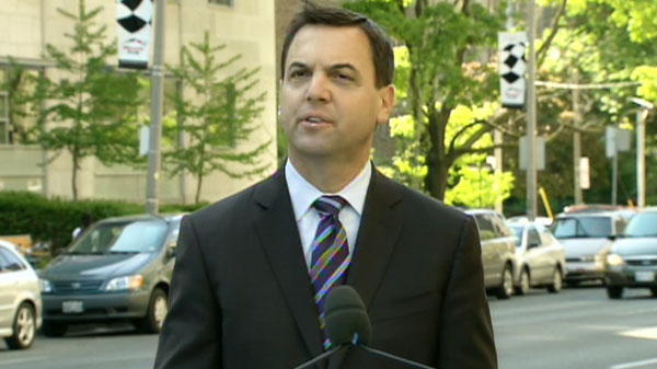 Tim Hudak annnounces he would boost health-care funding if elected premier during a news conference on Tuesday, May 24, 2011.