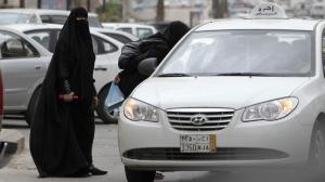 Saudi women board a taxi in Riyadh, Saudi Arabia, Tuesday, May 24, 2011. (Hassan Ammar/AP Photo)
