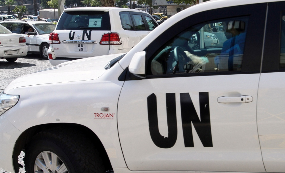 UN chemical weapons experts who are investigating last week's suspected poison gas attack on Syrian civilians leave the Four Seasons hotel and are expected to visit the site near Damascus, Syria, Wednesday, Aug. 28, 2013. (AP)
