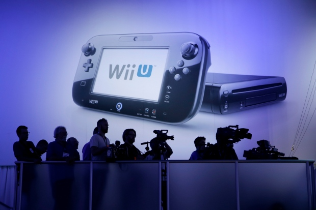 Members of the media watch a presentation from a riser at the Nintendo Wii U software showcase during the E3 game show in Los Angeles, Tuesday, June 11, 2013. (AP / Jae C. Hong)