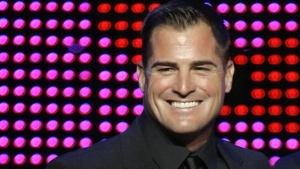 "U.S. actor George Eads holds the International Drama Series TV Audience Award for ""CSI: Las Vegas"" during the Festival's Golden Nymph Award ceremony of the 48th Monte Carlo television festival, Thursday, June 12, 2008 in Monaco. (AP / Lionel Cironneau)"