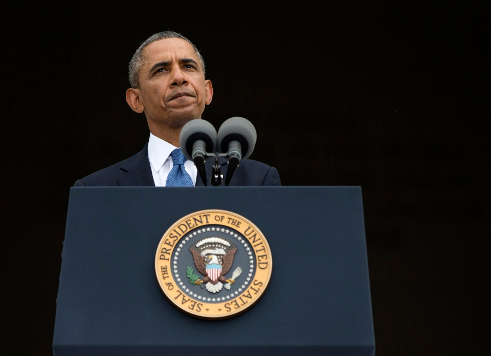 U.S. President Barack Obama pauses while speaking at a ceremony in Washington, Wednesday, Aug. 28, 2013.  (AP / Evan Vucci)