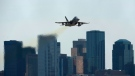 A Canadian Air Force CF-18 Hornet takes off from the City Centre Airport prior to the Edmonton Indy race in Edmonton on Sunday, July 22, 2012. (John Ulan / THE CANADIAN PRESS)