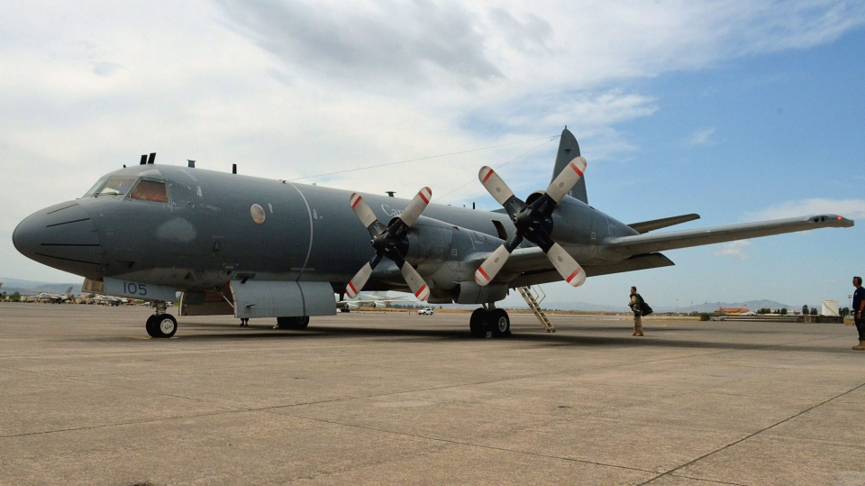 A Canadian CP-140 Aurora is seen on the tarmac at the Italian naval air station in Sigonella, Italy on July 25, 2011. (Murray Brewster / THE CANADIAN PRESS)