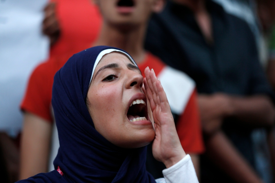 A demonstrator chants slogans during a protest against ousted President Hosni Mubarak's release from prison, in Cairo, Egypt, Wednesday, Aug. 28, 2013. (AP / Lefteris Pitarakis)