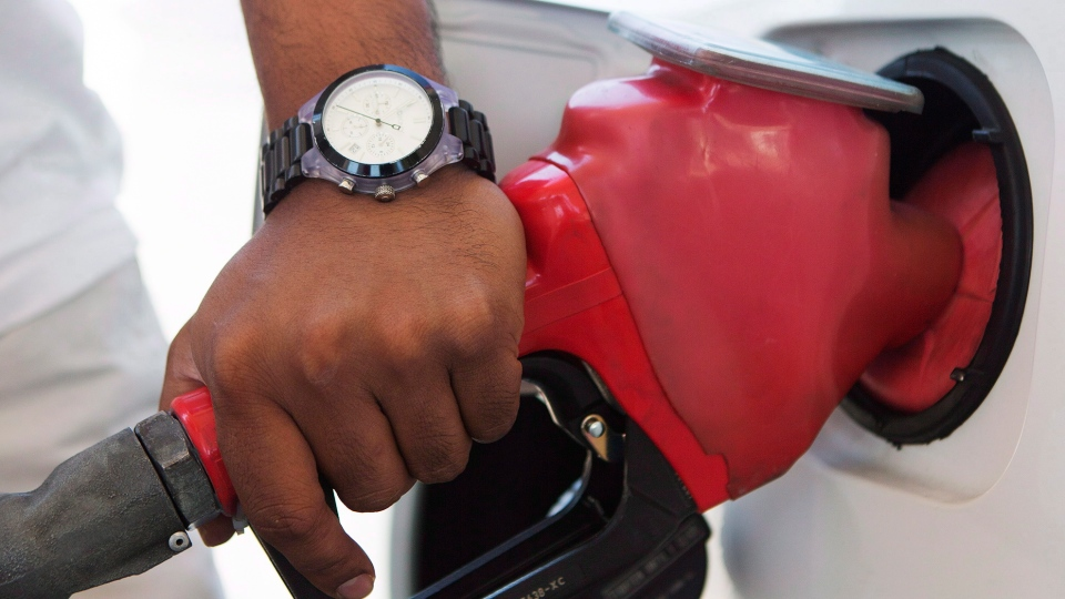 A man pumps fuel in Toronto. (The Canadian Press/Michelle Siu)